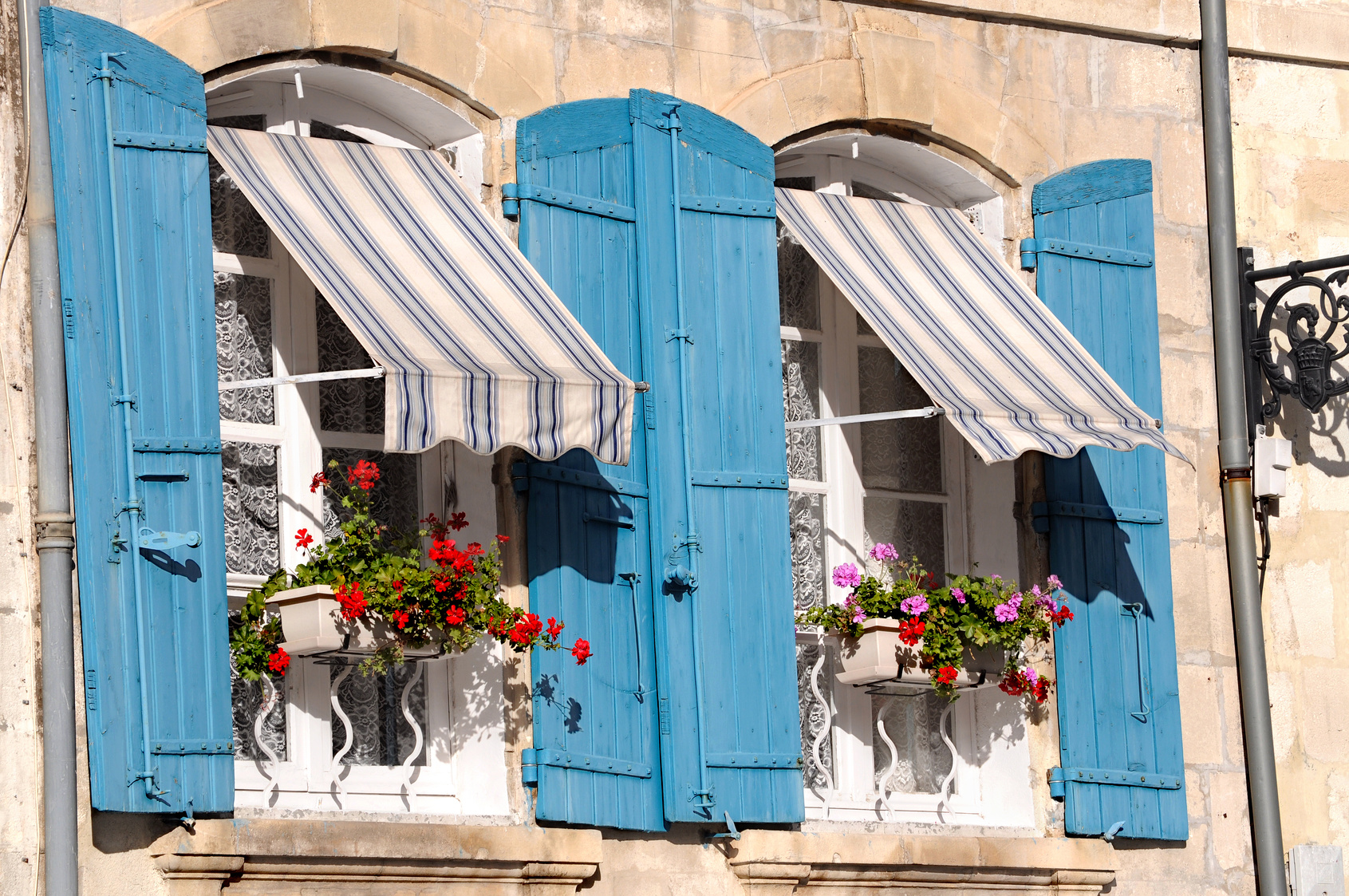 Provencal style of French blue window with flower window bed boxes