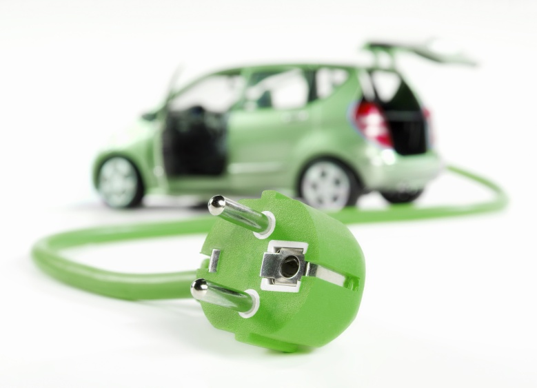 electric green car with plug to charge