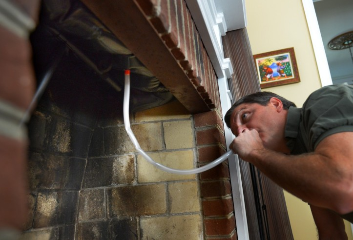 man inflating ballon for chimney in his home to prevent air draught and insulate home