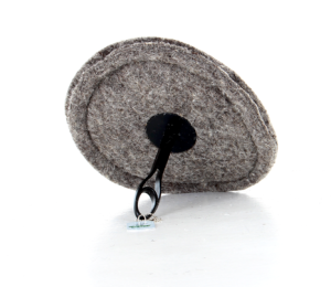 Round sheep's wool draught excluder