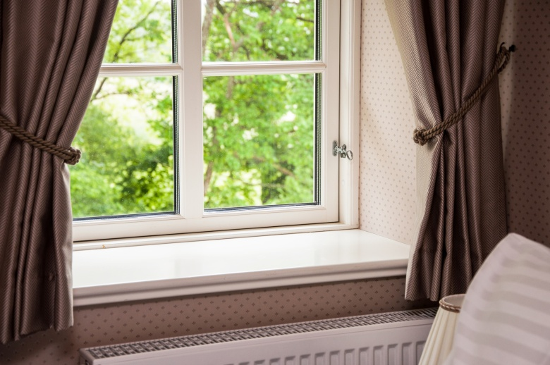 curtains over the radiator to prevent stack effect and provide insulation