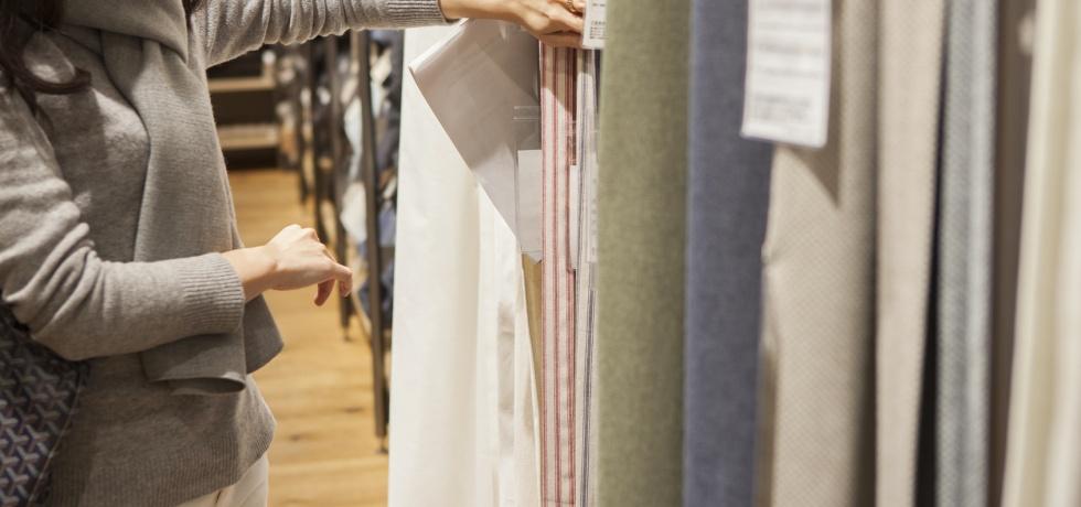 woman choosing fabric