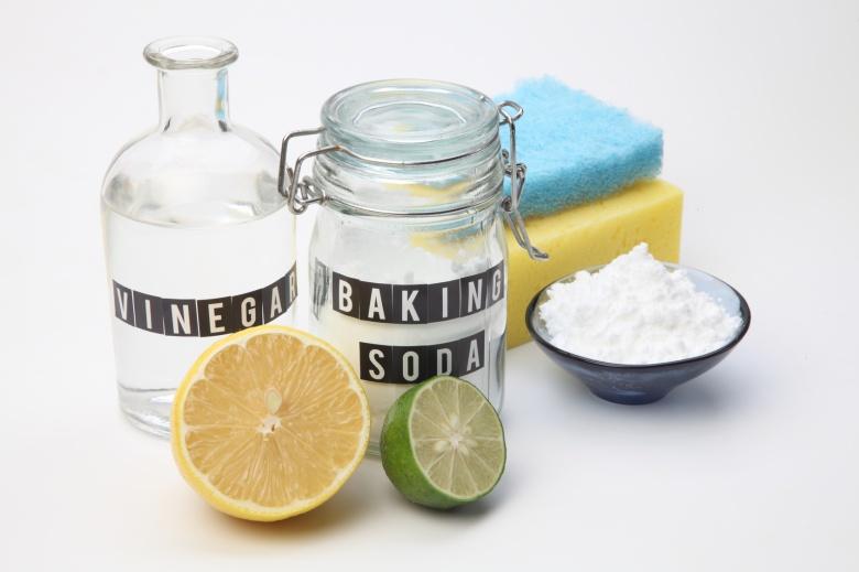 Homemade green cleaning. Lemon, baking soda and salt on white background