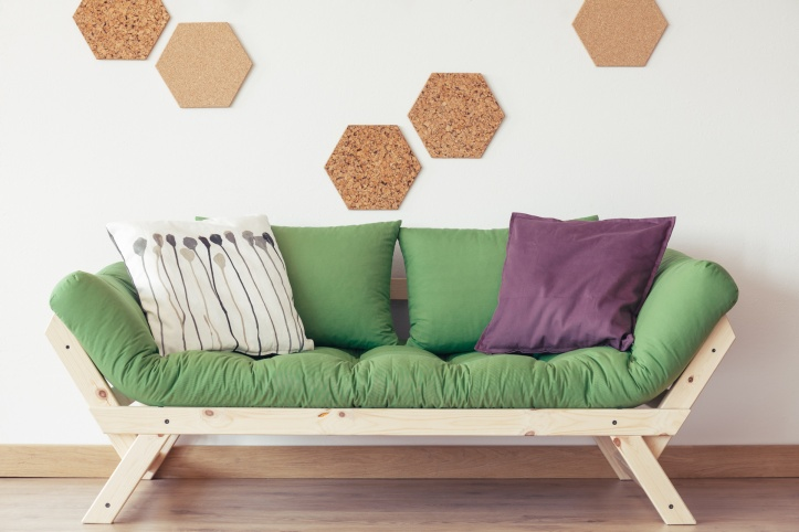 Green sofa in nature-inspired interior