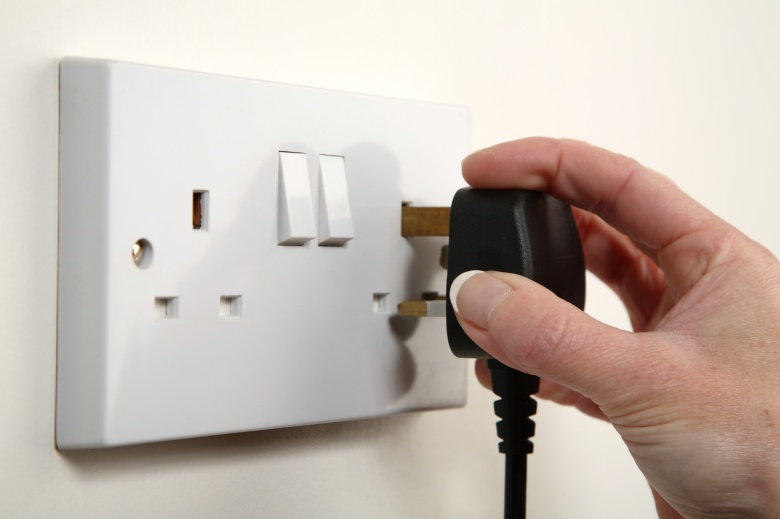 unplugging on a white UK socket with small switches