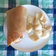 sanwich in eco takeaway paper wrap from if you care brand on a plate